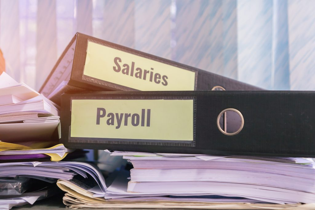 You can't afford to mess up your payroll - Salaries & Payroll folders stacked.