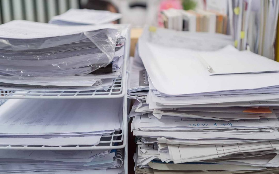 What should I do with my paper bookkeeping documents?